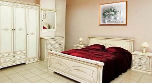 дизайн спальни в бежевых тонах фото